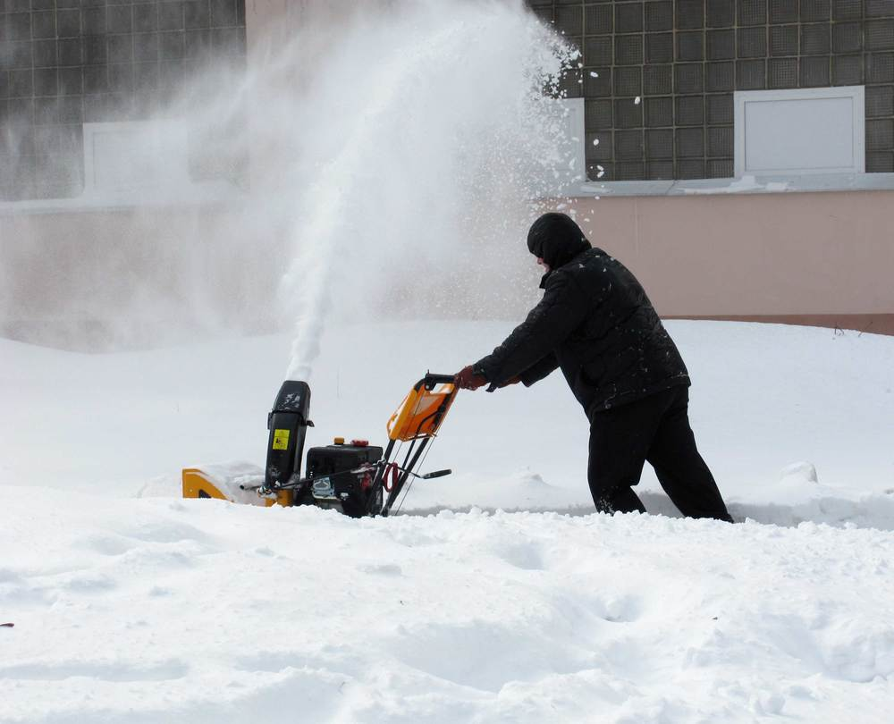 Snow-removal-with-a-snow-blowe-43869010